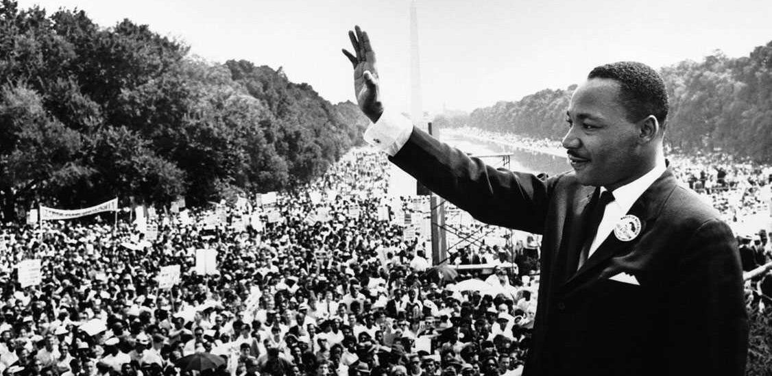 Martin Luther King Jr. waving at a crowd in Washington DC