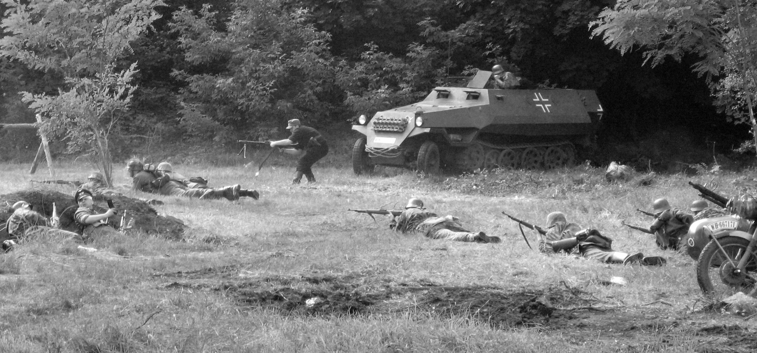 A battle with a tank coming out of a forest